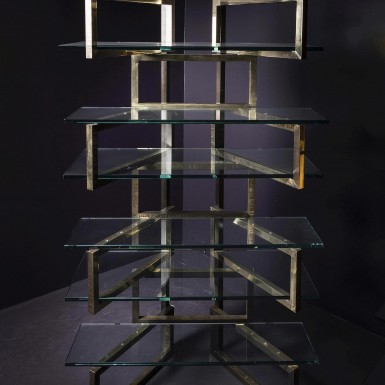 Bookcase in brass and glass - on sale at Nilufar Gallery Milan